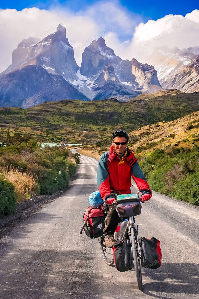 Cycling in front of Cuernos del Paine