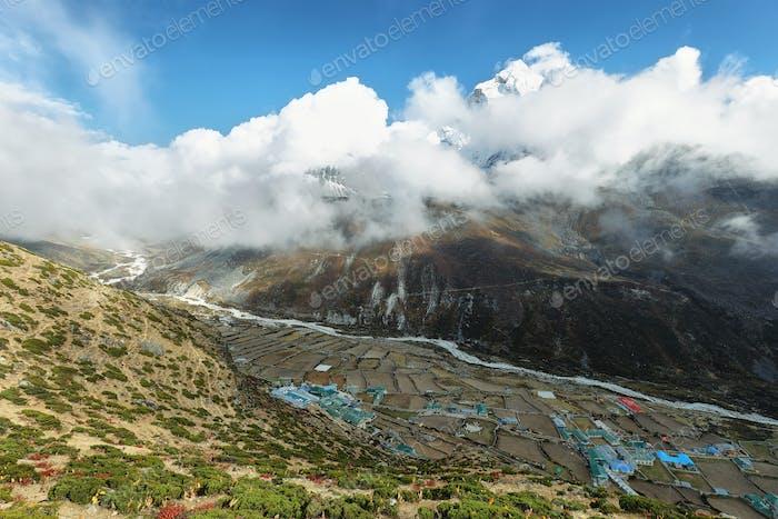 Dingboche village with Ama Dablan peak behind between clouds