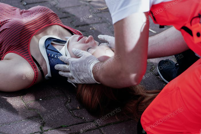 Close-up of a paramedic helping a car accident victim