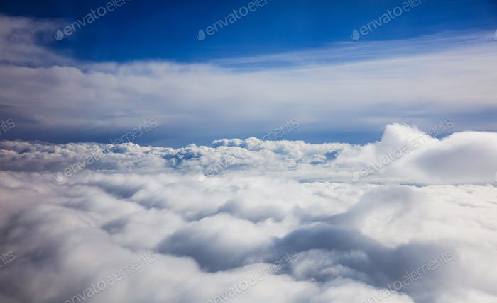 Blue sky and clouds - view from plane window
