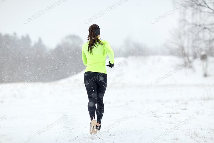 woman running outdoors in winter