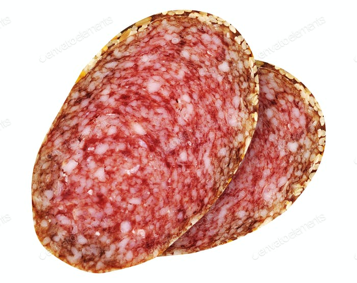 Slices of salami isolated on white