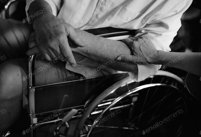 Closeup of support hand for handicap husband