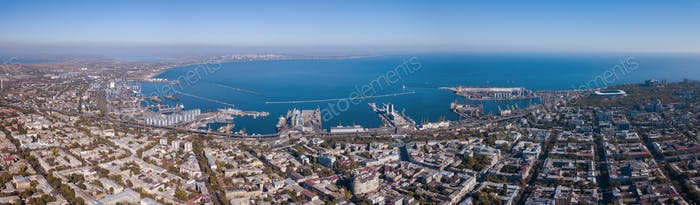Panorama of the city of Odessa and the sea with a port against a blue sky on a sunny day. Aerial