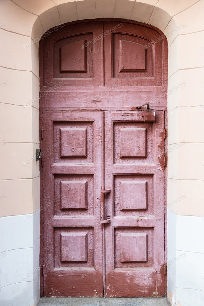 old painted shabby wooden outdoor door of house