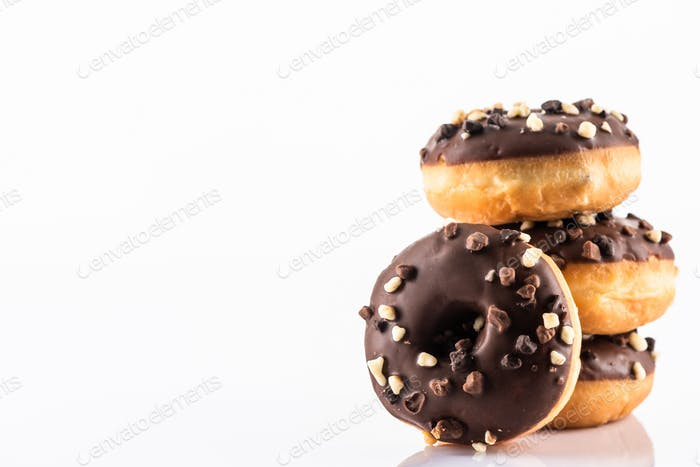 Chocolate Donut or Doughnuts on White Reflective Background with Copy Space