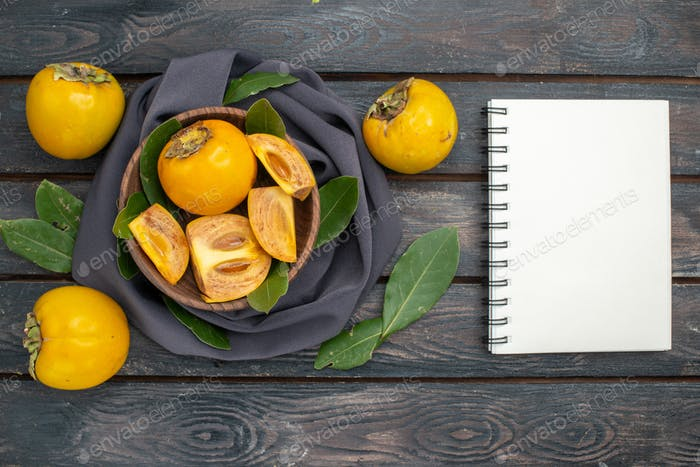 top view fresh sweet persimmons on wooden desk fruit tree ripe mellow
