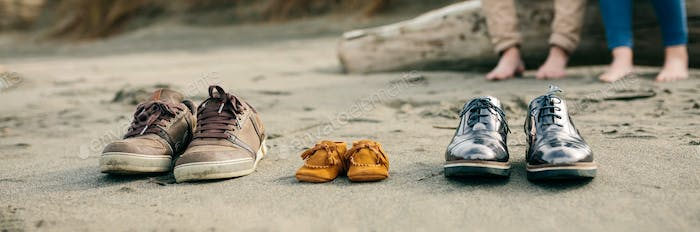 Family shoes in the sand