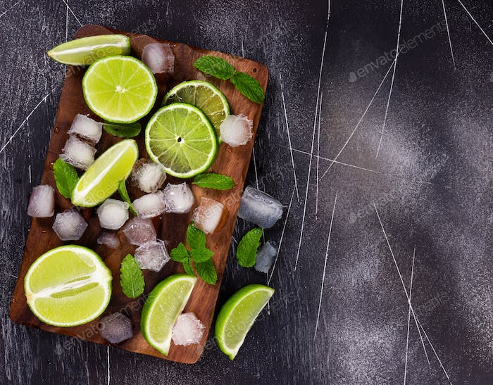 Fresh lime, mint and ice on cutting board. Ingredients for Mojito.