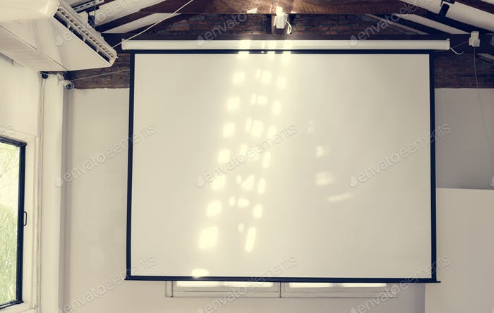 A projector screen on a meeting room