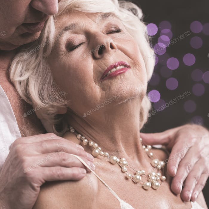 Senior man touching fondly wife
