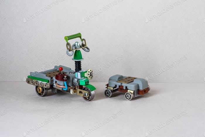 Grüner Roller mit Getriebe, Fahrerplatz, Elektrobatterie Skateboard