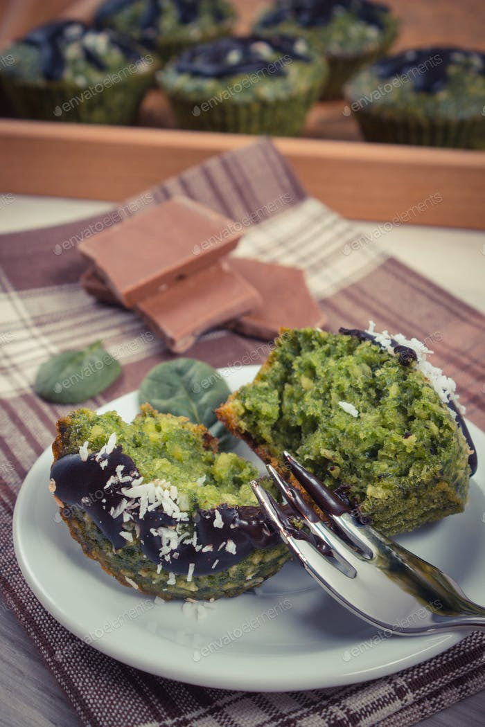 Vintage photo, Fresh muffins with spinach, desiccated coconut and chocolate glaze