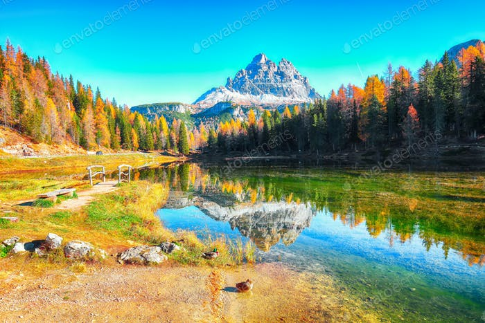 Stunning view of popular travel destination mountain lake Antorno in autumn