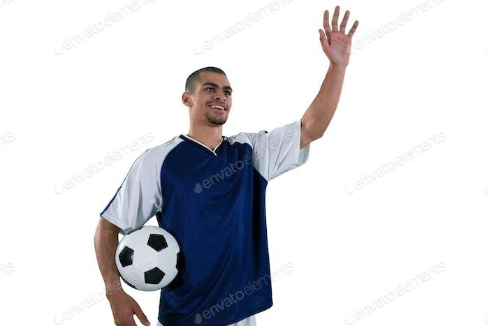 Football player waving his hand