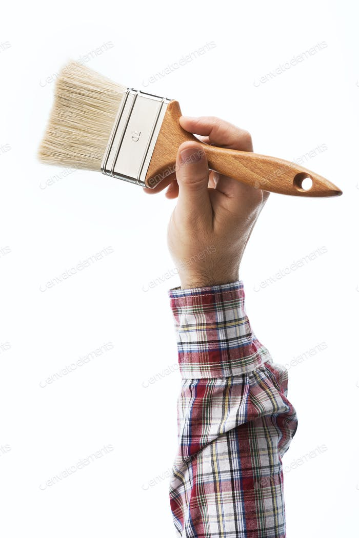 Decorator holding a paintbrush