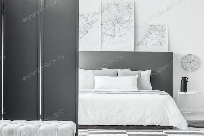 Maps in minimal hotel interior
