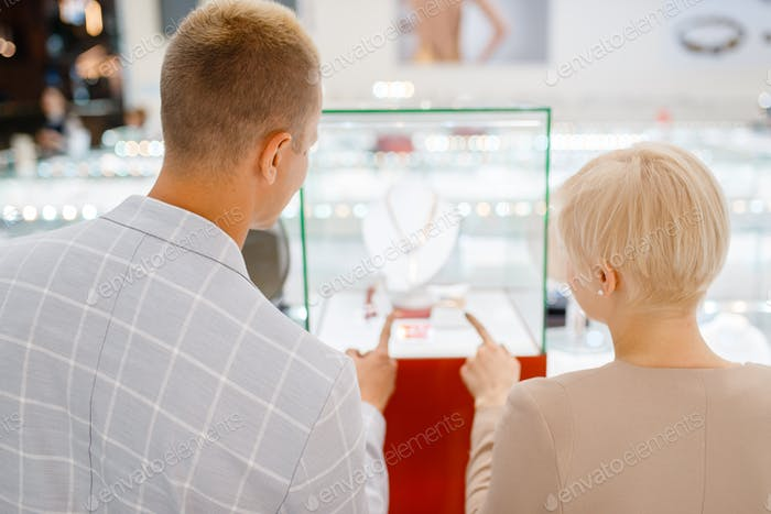 Male and female customers in jewelry store