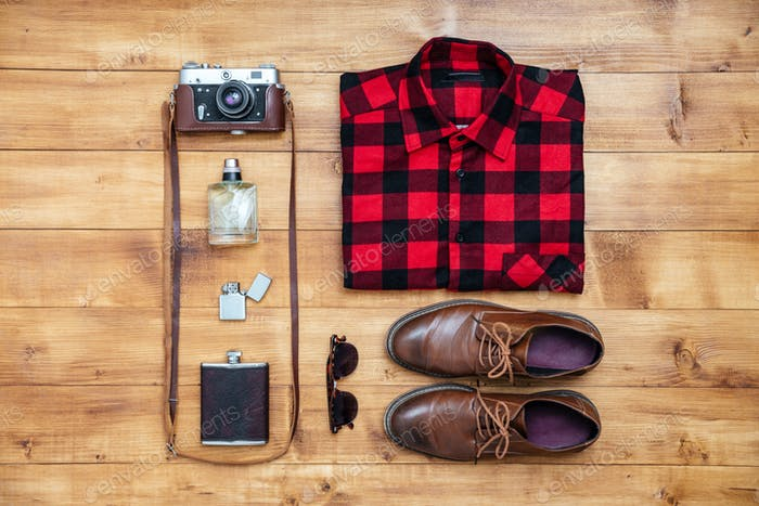 Travel concept shirt, camera, shoes, flask, lighter,eyeglasses, perfume