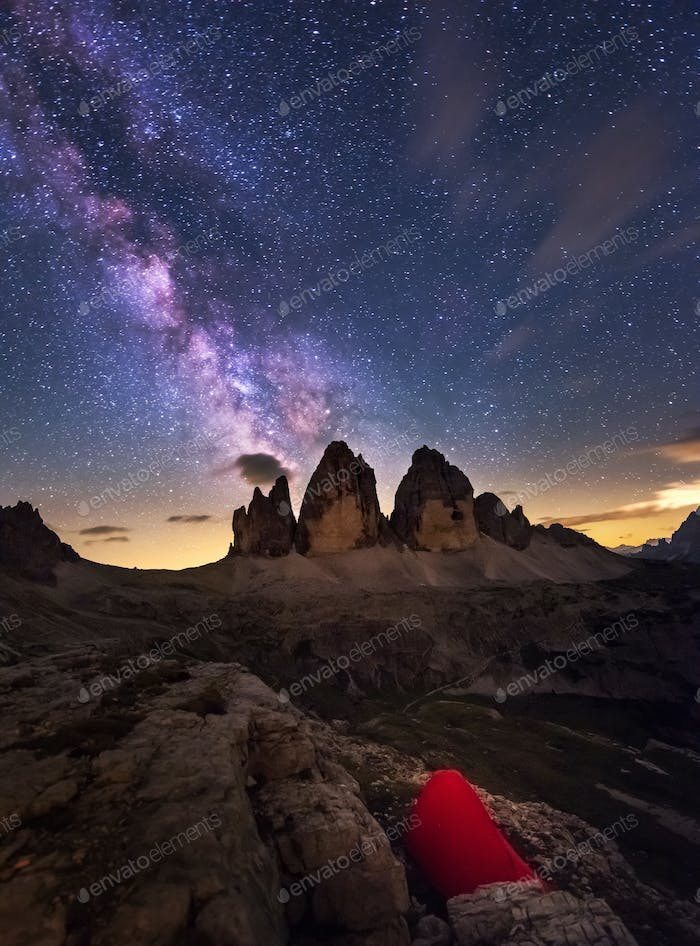 Tent under the starry night in the Dolomites mountains