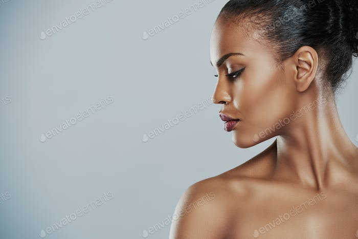 Woman looking sideways over gray background