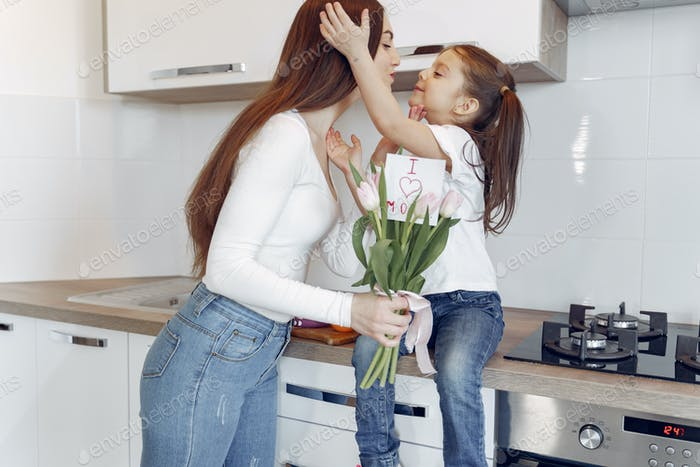 Mother with daughter at home