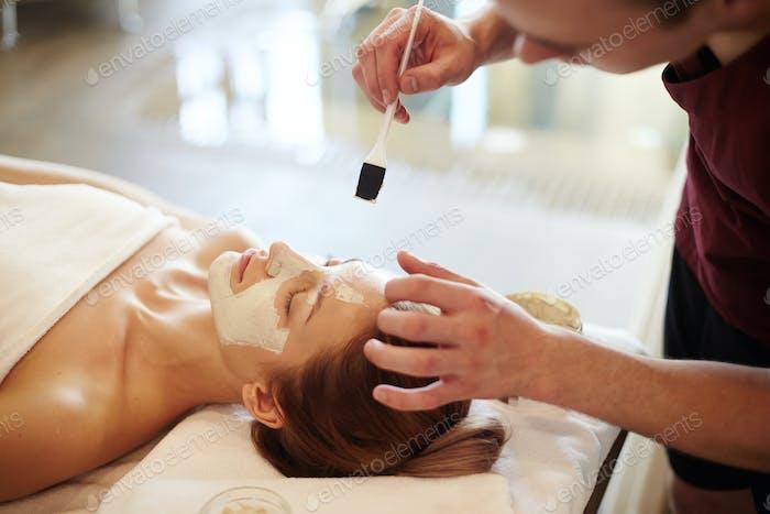 Woman Enjoying Beauty Treatments in SPA