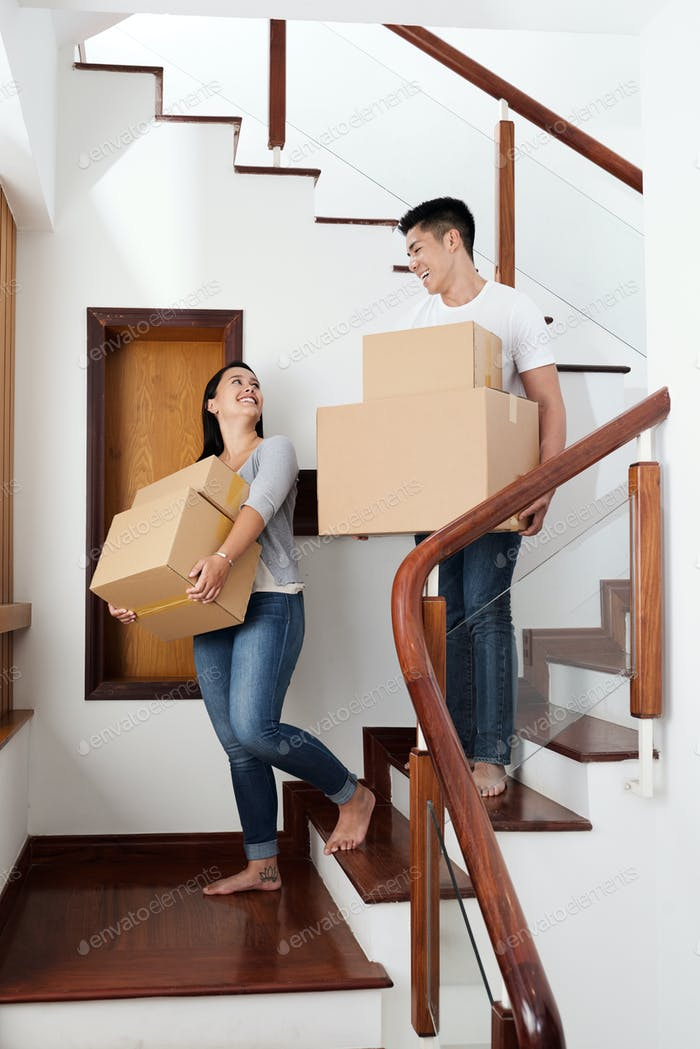 Couple with packed belongings