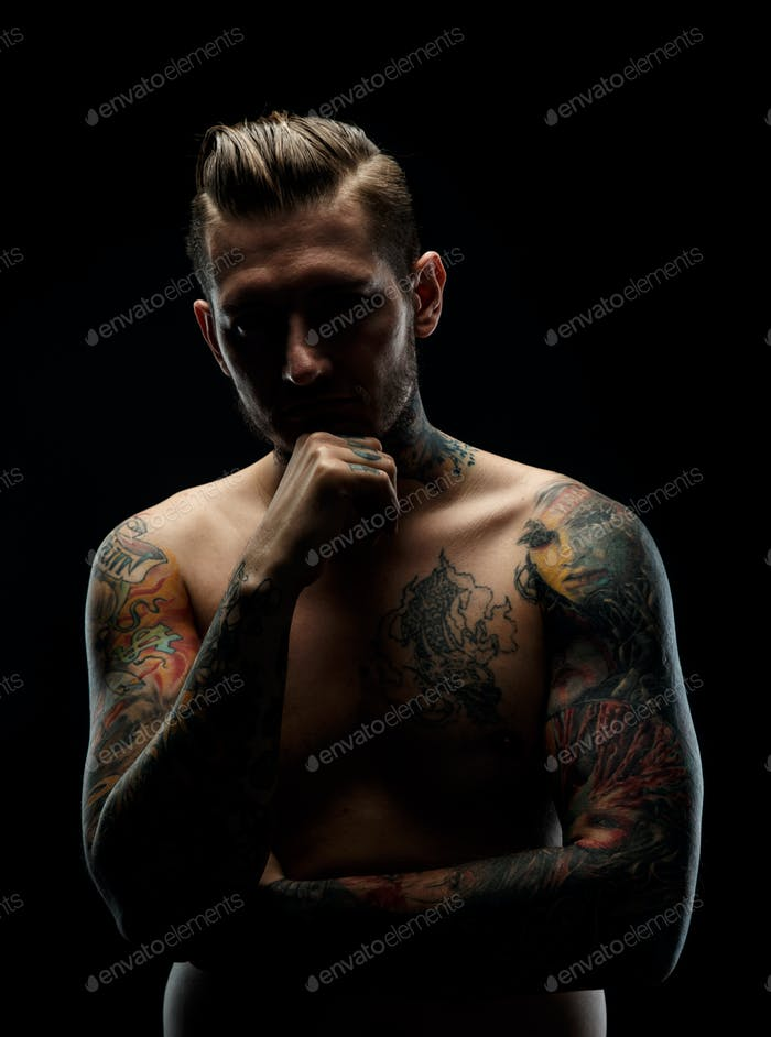 Portrait of a manwith tattooes.