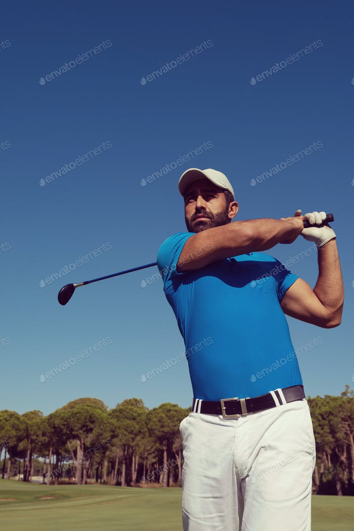 golf player hitting shot