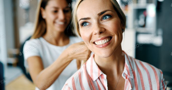Happy woman at the hair salon