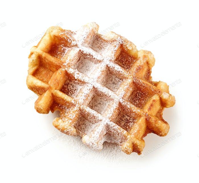 freshly baked belgian waffle with powdered sugar