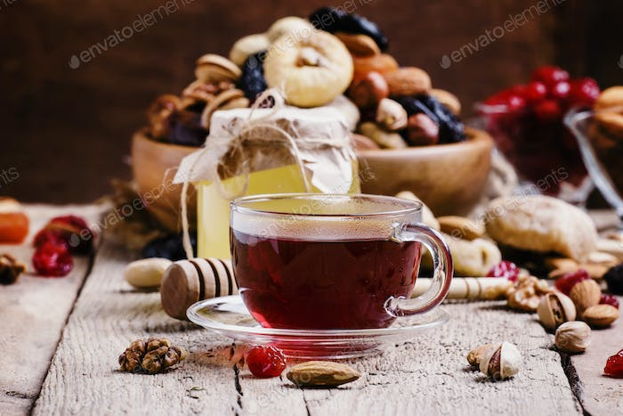 Middle East black tea in a cup with dried fruits and nuts