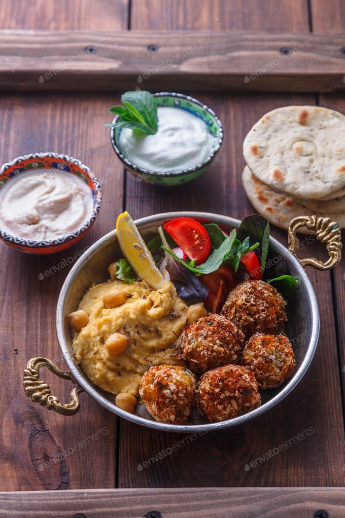 Hummus, falafel, salad with pita, tahini and yoghurt