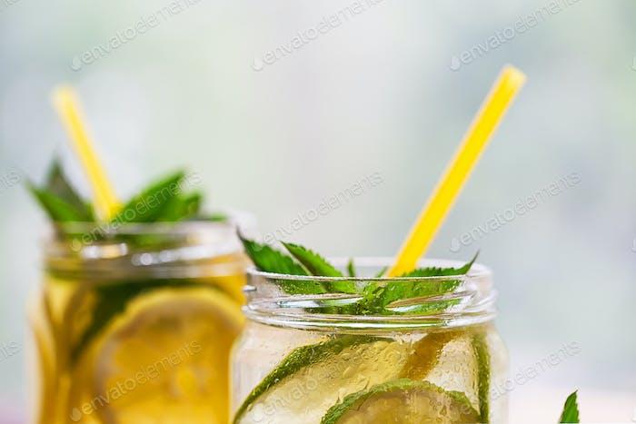 Fragment of jars with lemonade