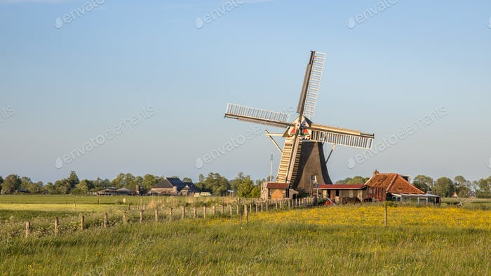 Wooden windmill on countryside