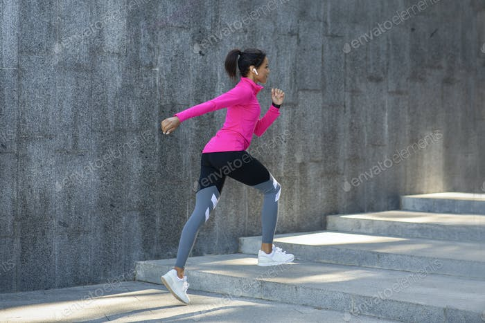 African woman in sport clothes jogging outdoor