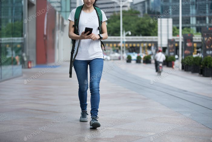 Woman use mobile phone on street