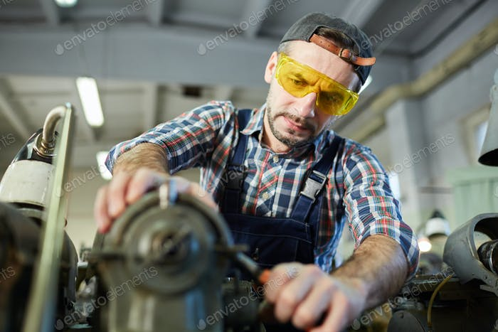 Worker at Metalworking Factory