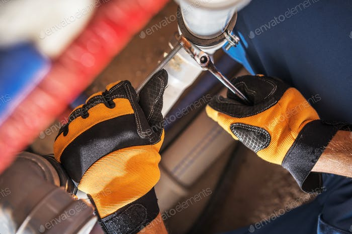 Plumber Worker Adjusting Water and Sewage System Elements
