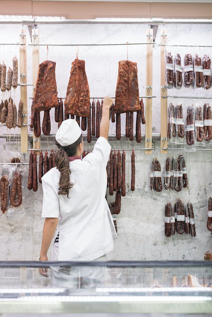 Pretty Butchery Woman working.