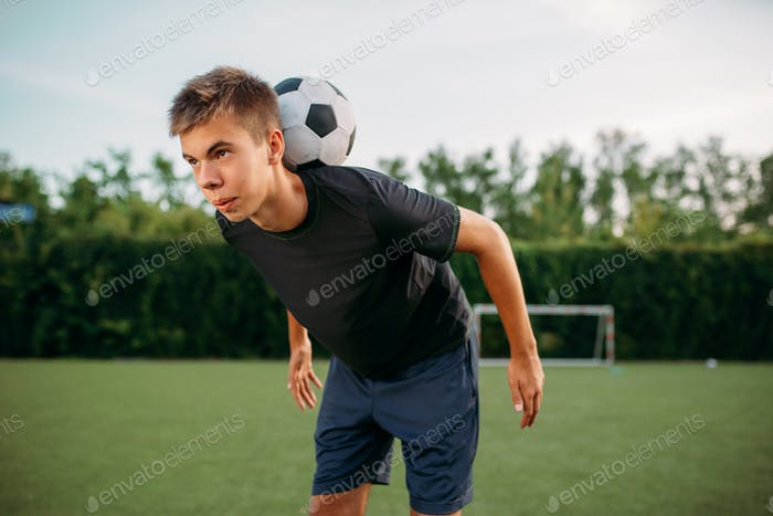 Soccer player keeps balance with ball on his neck