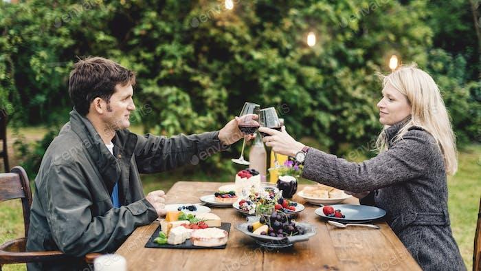 Couple Cheers Love Wine Concept
