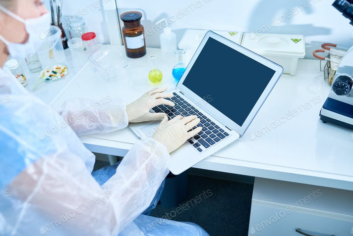 Busy researcher typing scientific article