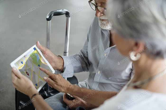 Old couple travel map route