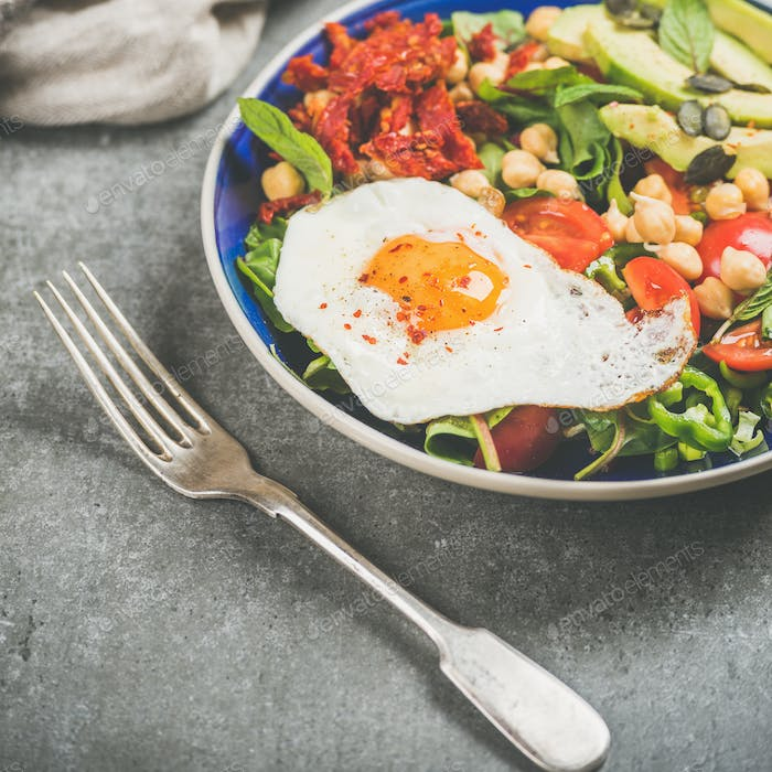 Dieting concept breakfast with fried egg, chickpea, vegetables, seeds