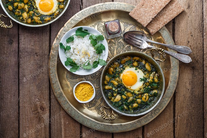 Eggs with bean, dill and rice. Iranian breakfast