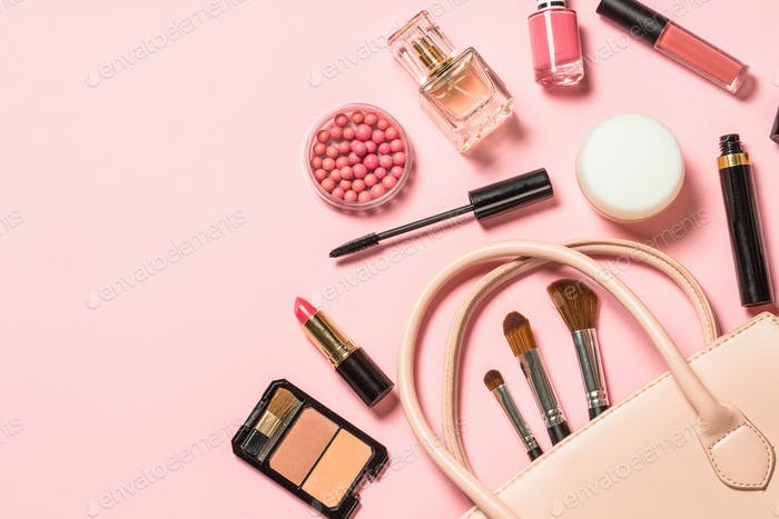 Cosmetics and makeup product on pink background