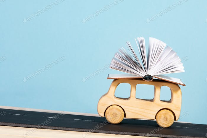 children's education. children's bus carrying a book