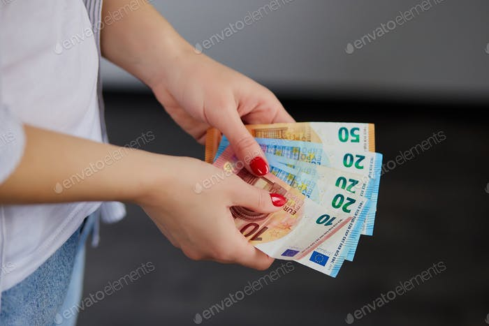 Woman hands counting euro money, holding in her hands.